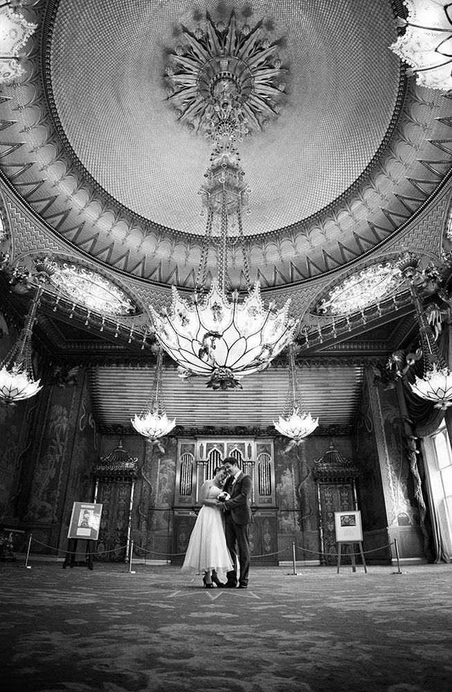 bride and groom in the music room